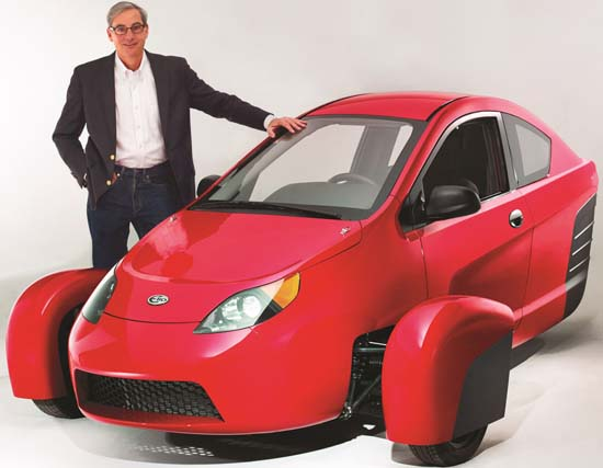 Paul Elio, CEO of Elio Motors, stands beside the Elio, a high-mpg, low-cost, three-wheeled car that will be manufactured in the USA using approximately 90 percent North American content. Image courtesy of Elio Motors.