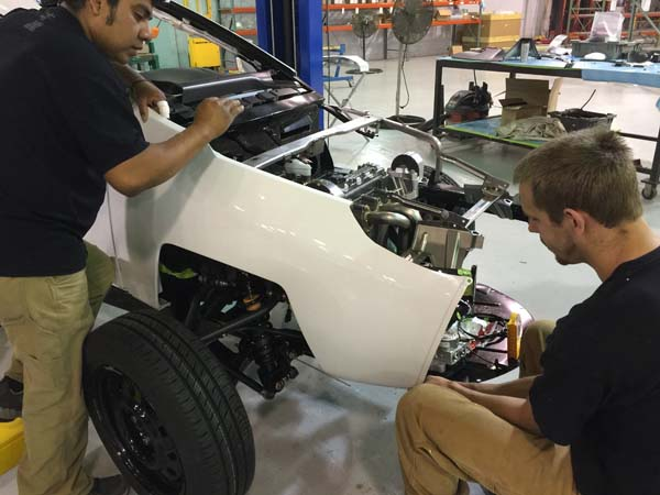 Technicians install the right-front fender of the Elio E-Series vehicle at the Elio Motors Pilot Operations Center in Livonia, Michigan. Elio Motors plans to build 23 E-Series vehicles for crash and validation testing, prior to moving to commercial production of the vehicle in its assembly facility in Shreveport, Louisiana. Image courtesy of Elio Motors.