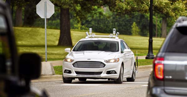 A Ford Fusion autonomous test vehicle, with LiDAR sensors on its roof, takes a spin on a public road. Image courtesy of Ford Motor Company.